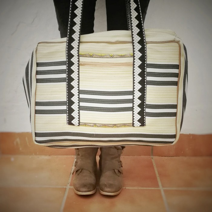 Pale yellow and black Weekend bag