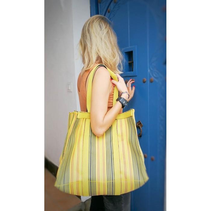 Yellow shopping bag or medium storage bag