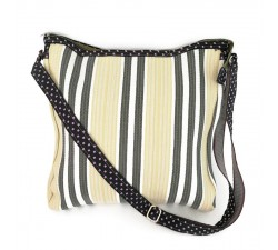 Pale yellow and black bag with long handle.