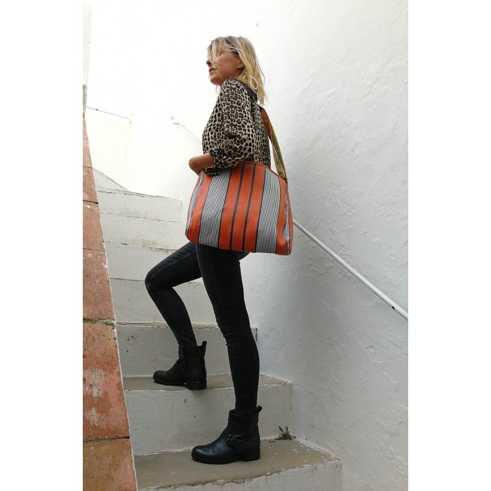 Orange and black bag with long handle.